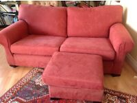 Three seater settee and foot stool.