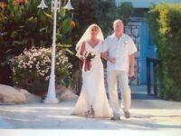 Beautiful ivory wedding dress for sale.