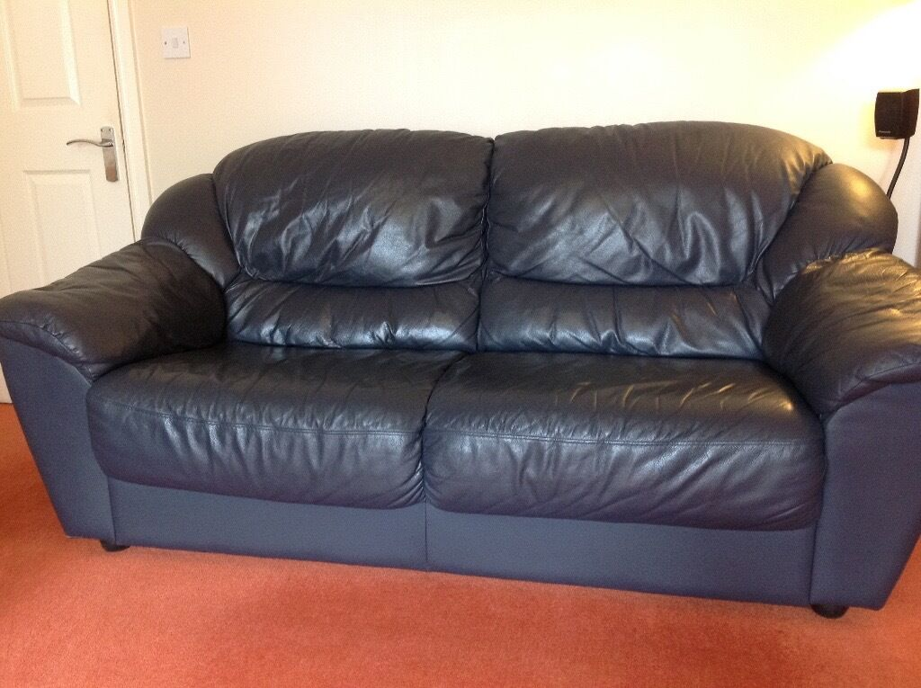Large dark blue leather sofa (3-seater). Used. In good condition