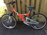 Child's red Apollo excel bike