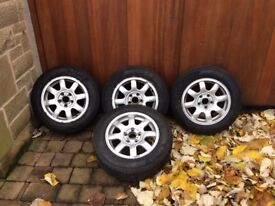 Set of 4 winter tyres with Audi alloy wheels 195/65R15.