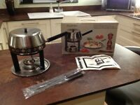RETRO 1975 FONDUE SET inn stainless steel with its original box. Excellent condition