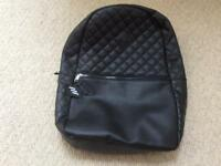 Black rucksack never used & still with tags on