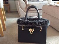 Black leather hand bag for sale real leather and real fur. Used only once..