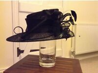 Ladies black asymmetric formal hat