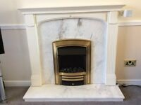 Electric fire with marble and white wood surround