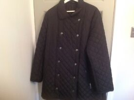 Women's black quilted jacket