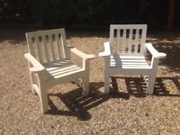Beautiful wooden chairs. Hand made. Painted white. One slat needs attention but very comfortable.