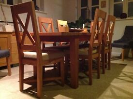 6 solid oak, cross back dining chairs with linen colour fabric seat.