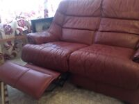 Faux leather double sofa single manual recliner good used condition cherry colour