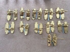 11 pairs of Bertelli brass door handles