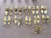 11 pairs of Bertelli brass door handles