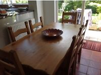 Large 6 foot long 3 foot wide Pine table with 6 chairs