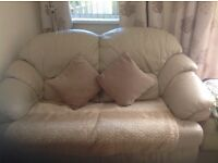 Two seater sofa and recliner chair