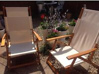 Two folding reclining low based chairs for sale.