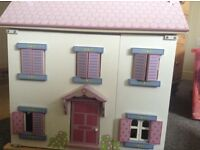 Wooden doll's house in immaculate condition. Wooden furniture and characters included.