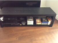 Wooden black tv table for sale in colchester.