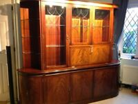 Dining room table in Mahogony and 6 upholstered chairs with matching display cabinet