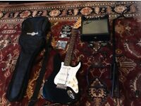gear4music guitar with amp, auto tuner, stand, bag and replacement strings