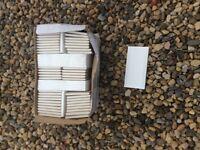 Box of white ceramic wall tiles.