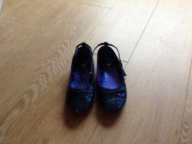 Girls blue shoes.