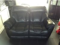 Pair of two and three seater black leather electric recliner sofas very good condition