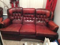 Three seater and two single chesterfield leather chairs for sale.