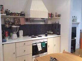 Spacious double bed in clean flat with excellent transport links in West Kensington
