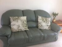 Green leather two settees one chair