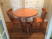 Round pine table & 2 chairs