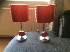 2 red table lamps
