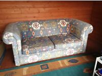 multi coloured 2 seater sofa, free to collector