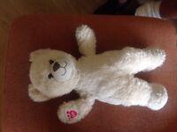 A cream coloured build a bear teddy 38 cm tall