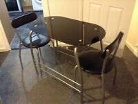 Black glass table plus two chairs