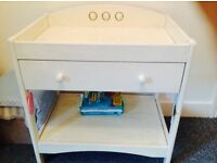 Baby changing table in white, with handy drawer and storage.