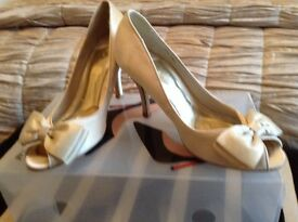Occasion satin shoes, size 3 with bow trim and 3ins heel. Worn once by bridesmaid