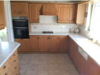 Complete fitted kitchen with 4 year old oven, freezer and fridge and additional utility units.