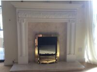 Fireplace. White plaster cast of sturdy construction.