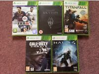 Five XBox 360 games - Halo4, Call of Duty, Titanfall, Skyrim and Fifa 14