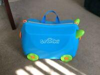 Blue Trunki child's suitcase.