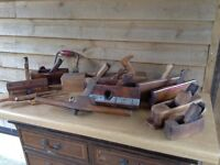 A selection of Antique joiners/carpenters planes.