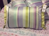4 next cushions New £6 each