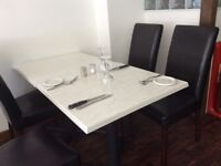 36 BROWN FAUX CHAIRS EXCELLENT CONDITION AND 13 WHITE MARBLE EFFECT TABLES