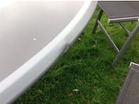 Round metal and glass (safety) table and 6 collapsible chairs