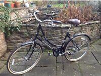 Dutch style sit up and beg bike