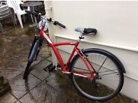 B Twin city/mountain hybrid bicycle with helmet and lock.