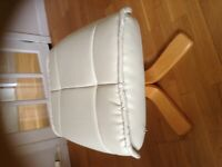Cream faux leather footstool with light wood feet -