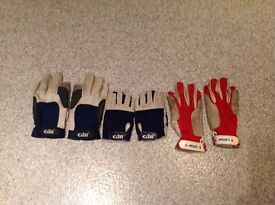 Pairs of Musto and Gill sailing gloves
