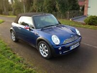 Mini Cooper convertible low mileage and a well kept car