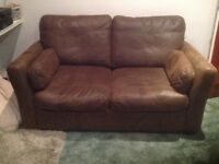 Two seater sofa bed in excellent condition. Heavy mattress. Material Faux. Comes with cleaning kit